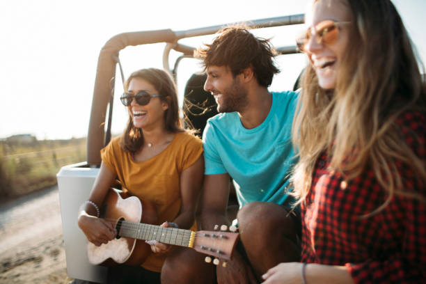 Play us a song! stock photo