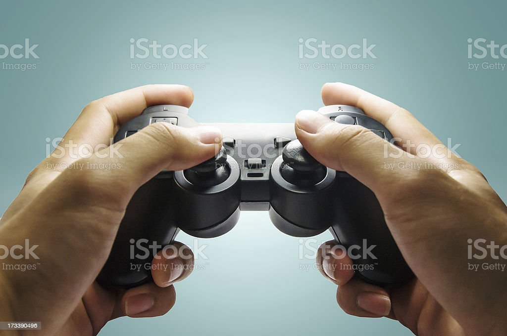 Play video game with a controller royalty-free stock photo