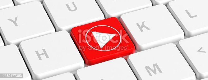 istock Play video. Red key button with a play sign on a computer keyboard, banner. 3d illustration 1135177363