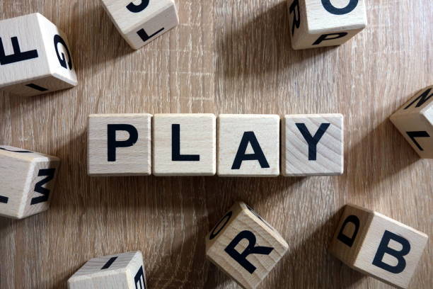 play word from wooden blocks - word game stock pictures, royalty-free photos & images