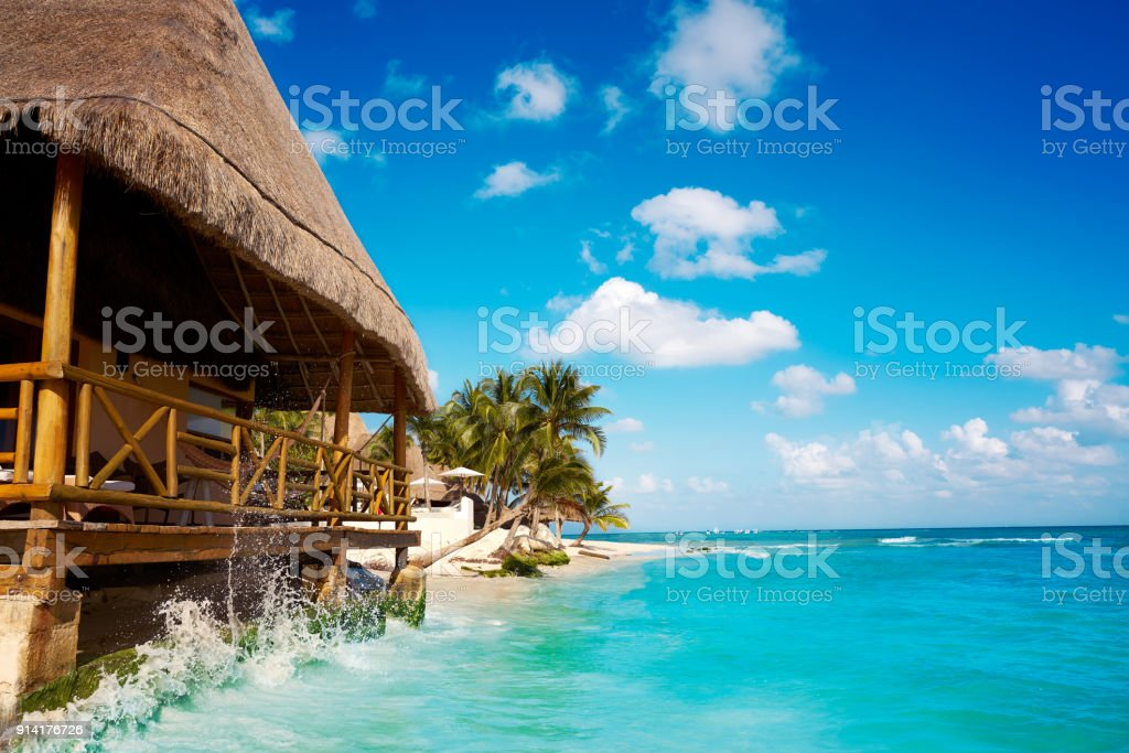 Playa del Carmen beach palapa in Mexico stock photo