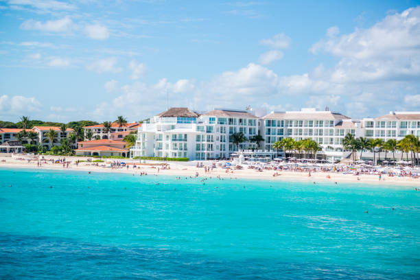 playa del carmen beach with tourists, mexico - playa del carmen stock photos and pictures