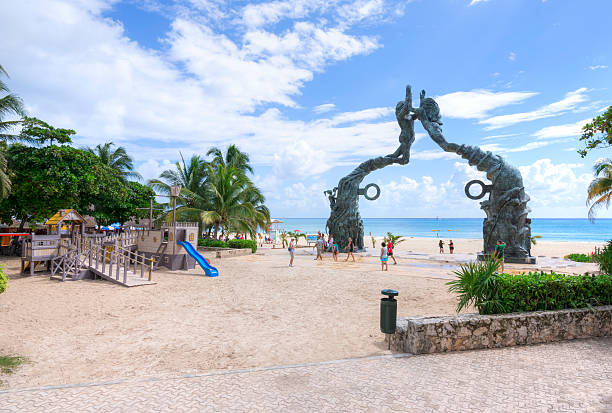 Playa del Carmen beachfront and playground stock photo