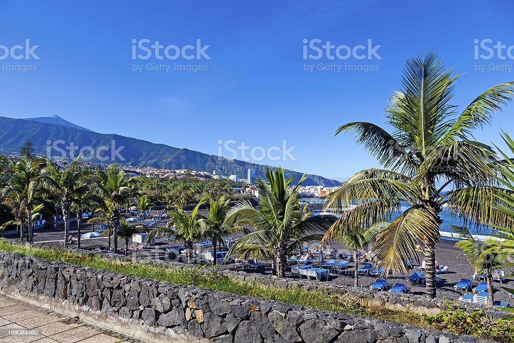 Playa Jardin and Teide Peak in Puerto de la Cruz stock photo