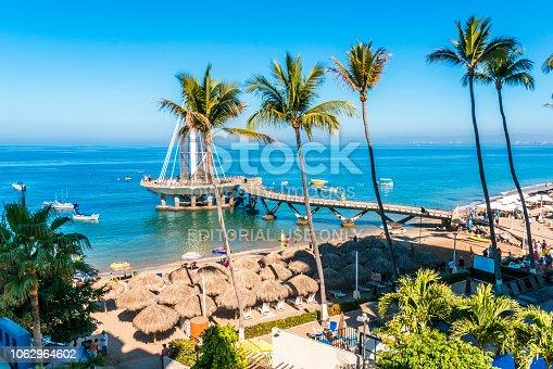 PUERTO VALLARTA, MEXICO - MARCH 14, 2018: , A scenic pier, Playa Los Muertos Pier, with a unique, contemporary design and busy scene on Los Muertos Beach, MX-JAL.