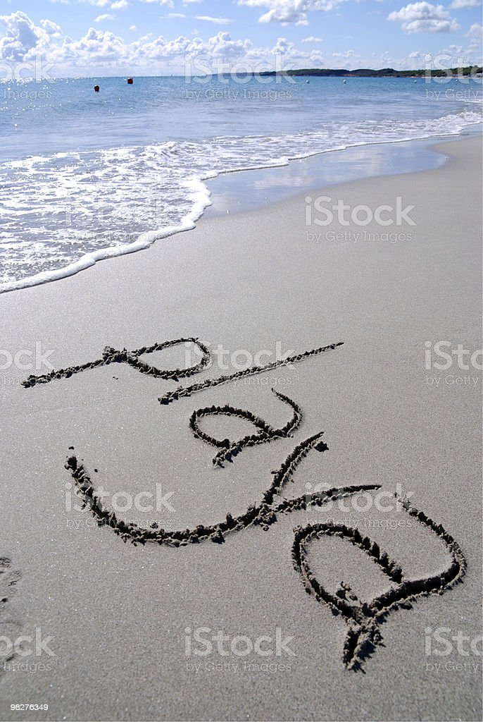 playa means beach in Spanish written by hand on sand royalty-free stock photo