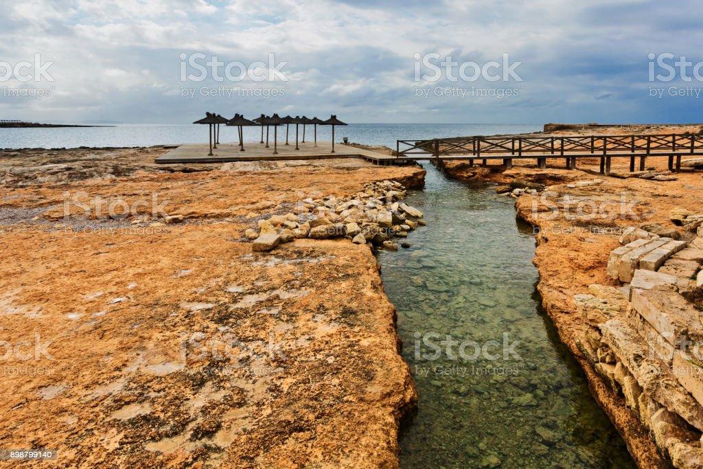 Playa Sa Bassa des Cabots in gloomy weather. Colonia Sant Jordi. Mallorca island stock photo