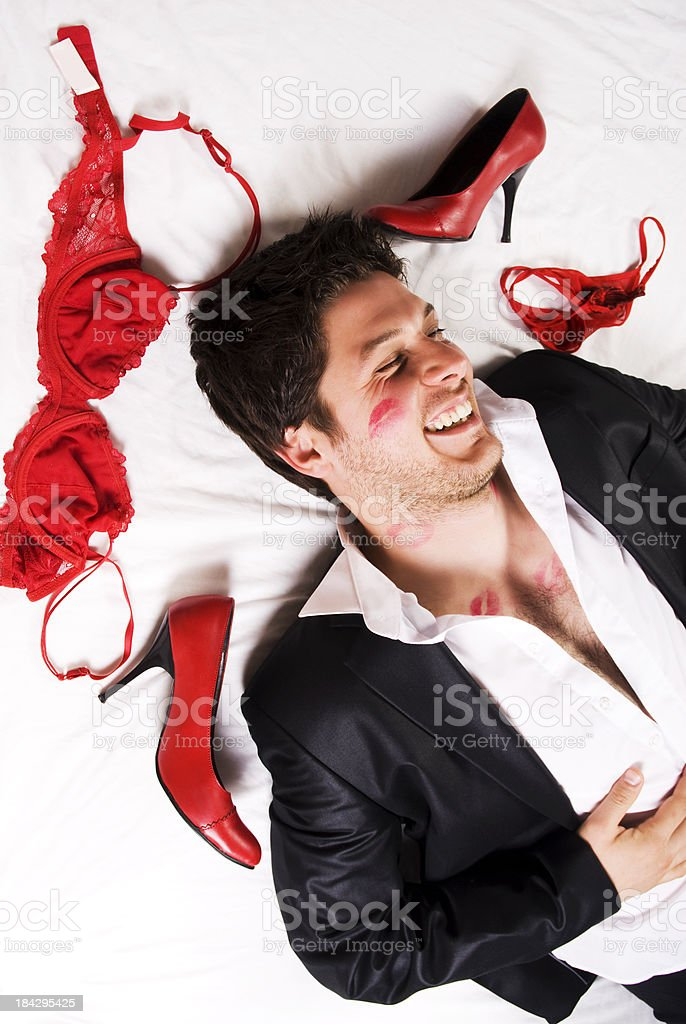 Playboy on the bed royalty-free stock photo