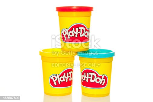 Dublin, Ireland - March 22, 2011: Three tubs of Play-Doh, the popular play-time activity for kids isolated on white bacjground.