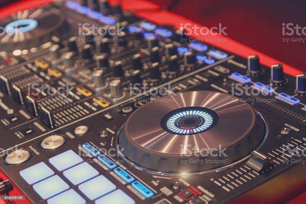 DJ player and mixer in nightclub. Music stock photo