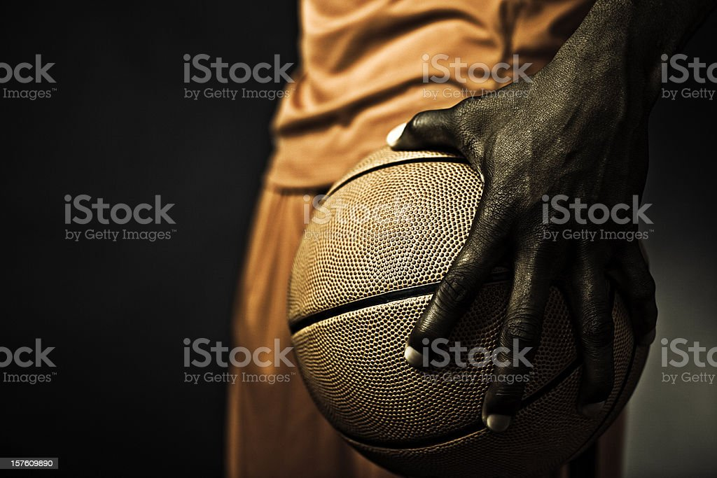 player gripping the basketball stock photo