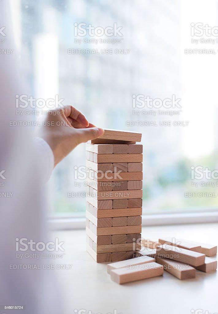Player hand build Jenga tower stock photo