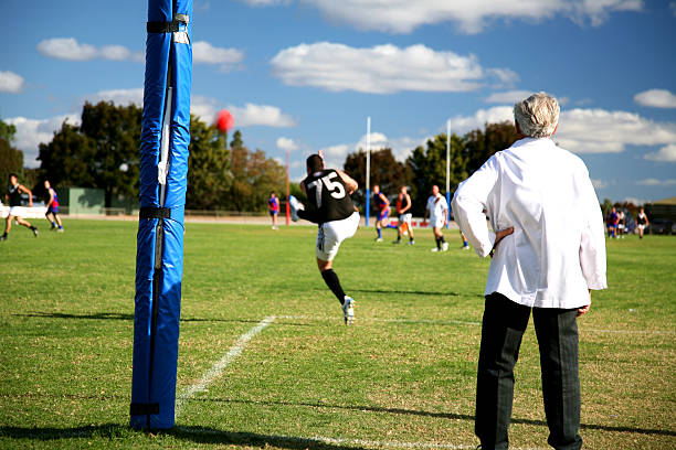 A player kicking the ball during practice in the field stock photo