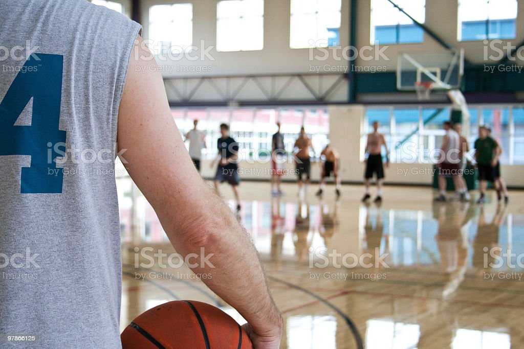 Player on the sidelines at a basketball game stock photo