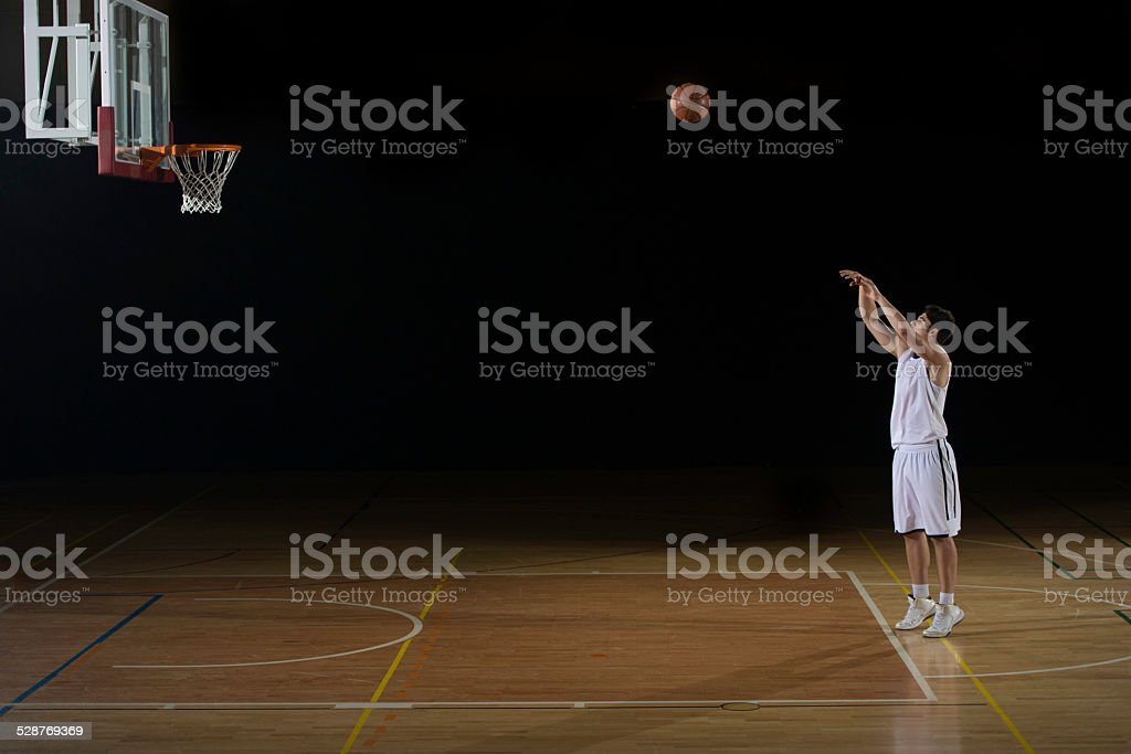 Player Practicing A Free Throw stock photo