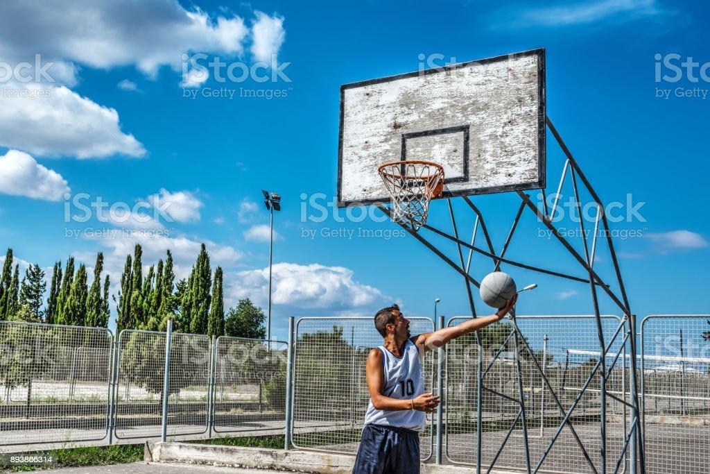 Player shooting a basketball stock photo