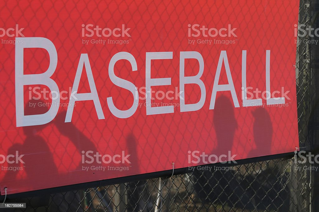 Player silhouette on red baseball sign royalty-free stock photo