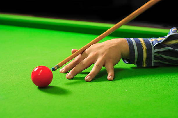 player trying to hit the ball - pool cue stock photos and pictures