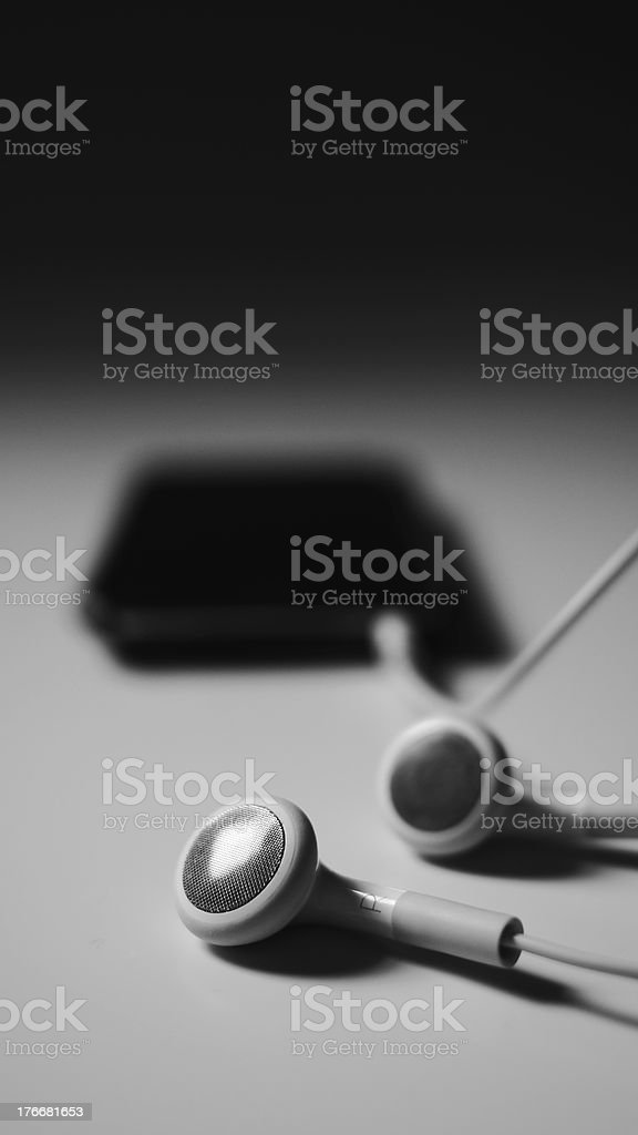 MP3 player with headphones connected royalty-free stock photo