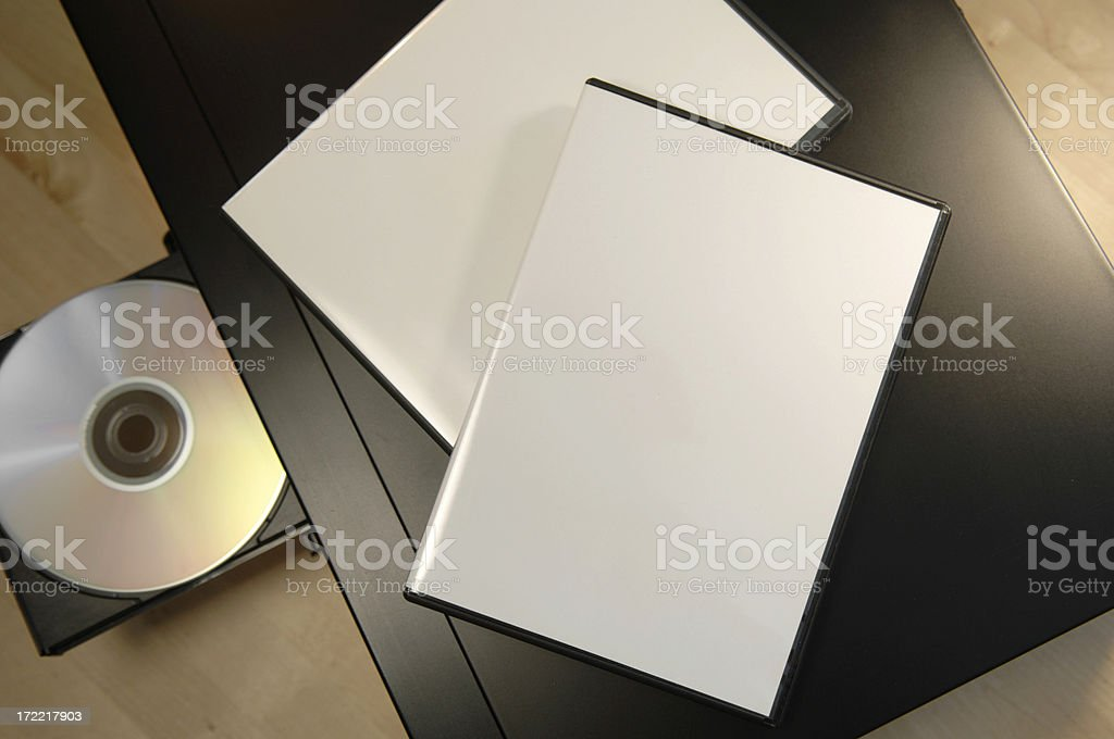DVD player with tray open and blank covers in top. stock photo