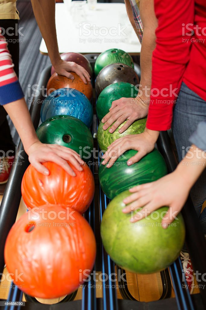 players hands and ball return system in bowling stock photo