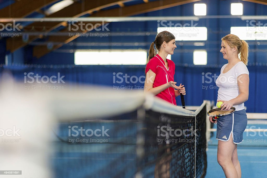 Players Talking By The Tennis Net stock photo