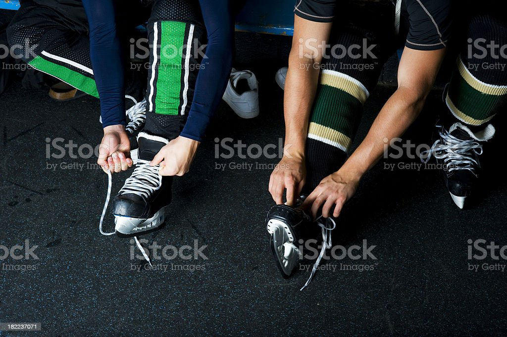 Players tying Skates royalty-free stock photo