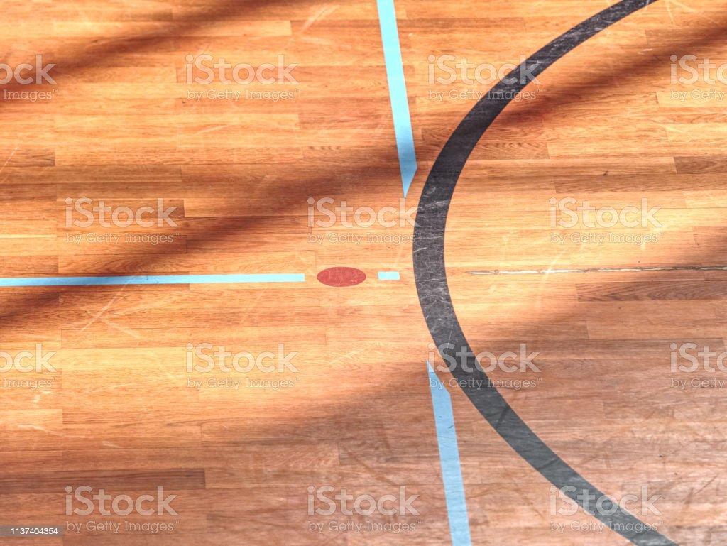 Playfield lines painted on renewal gymnasium wooden floor. Inside...