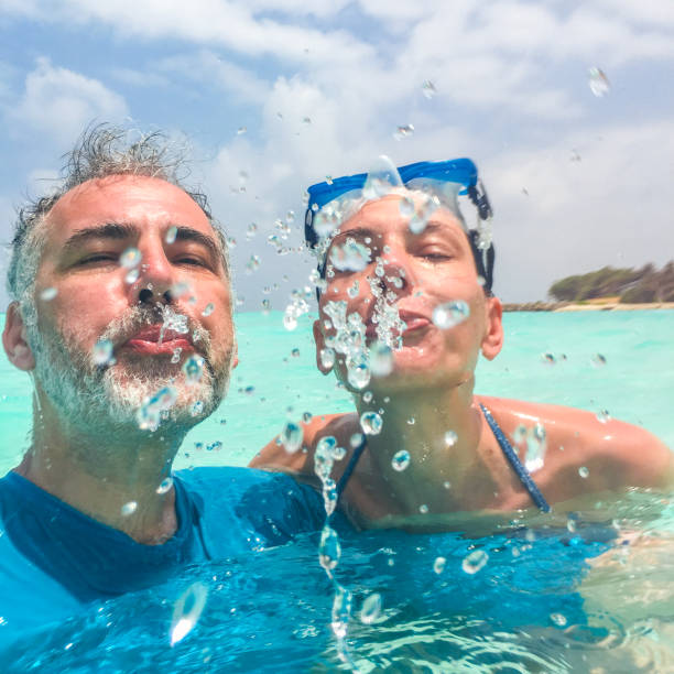 Couple Enjoying Their Summer Holidays Stock Photo: Spitting Water Stock Photos, Pictures & Royalty-Free