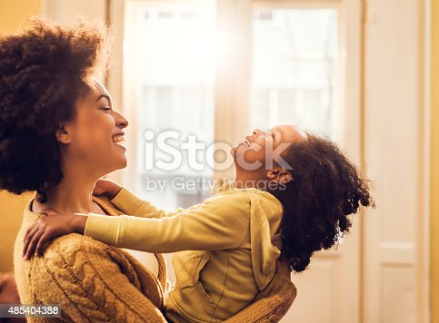 istock Playful African American mother and daughter having fun at home. 485404388