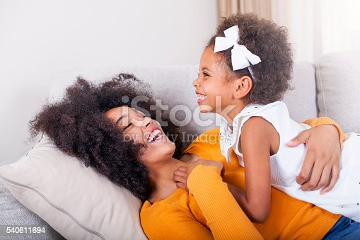 istock Playful African American mother and daughter having fun at home. 540611694