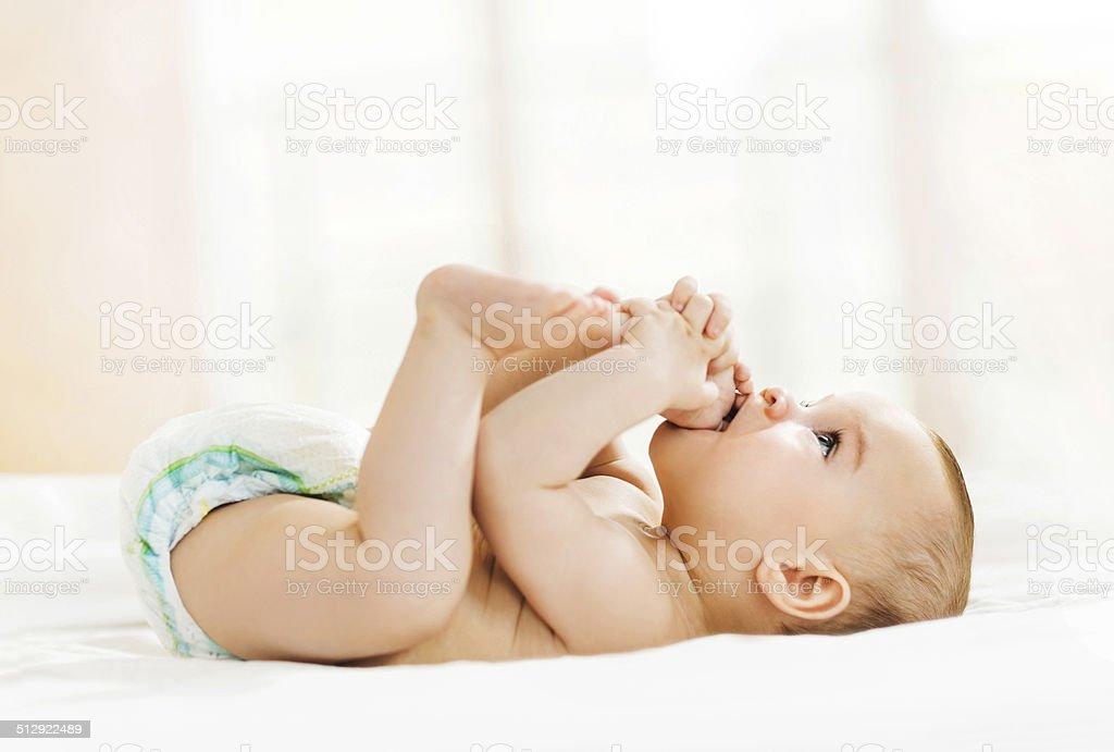 Playful baby boy. stock photo