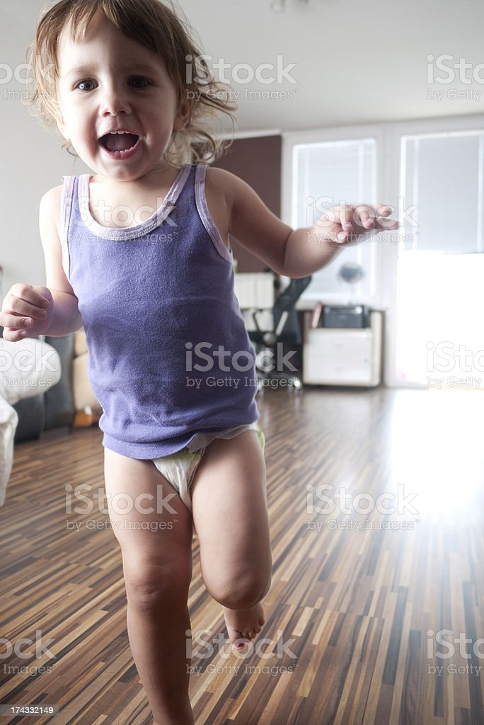 Playful baby girl stock photo
