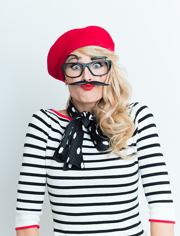 Playful Blonde French Woman Wearing Red Beret And Facial Mask Stock Photo - Download Image Now