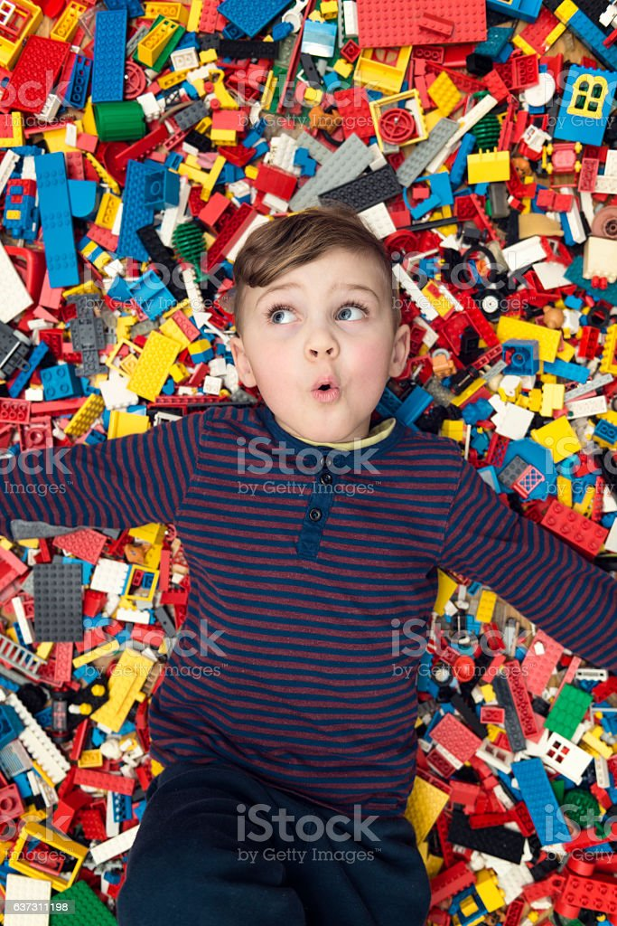 playful boy between plastic blocks stock photo