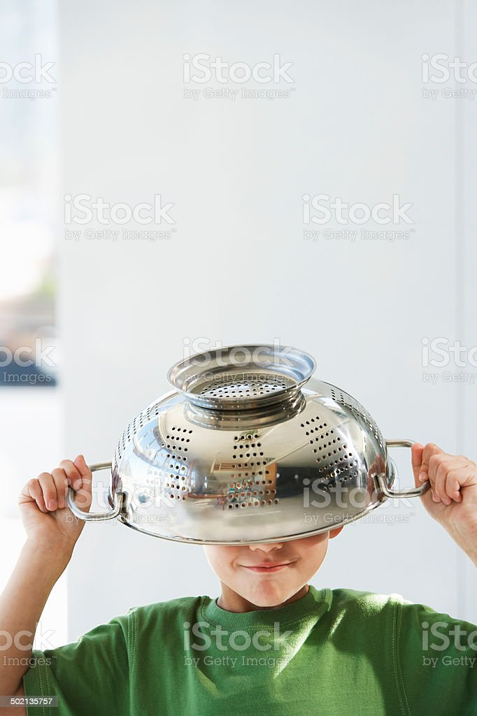 Playful Boy With Colander On Head stock photo