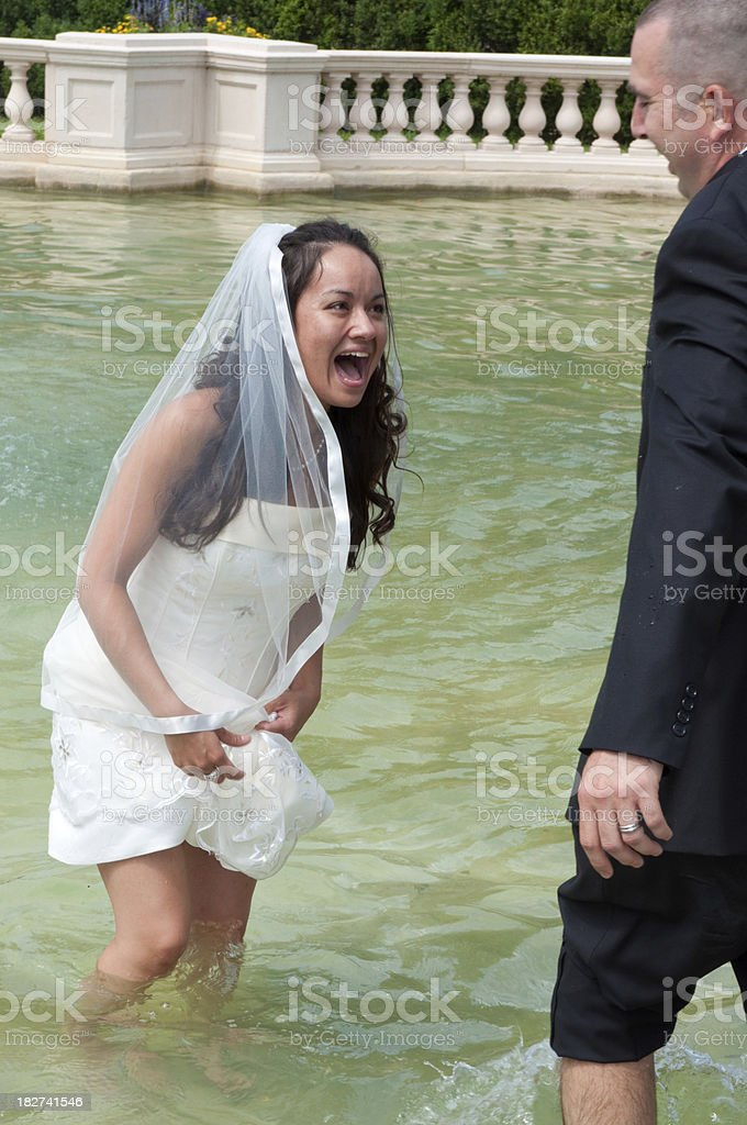 Playful Bridal Couple in Fountain royalty-free stock photo