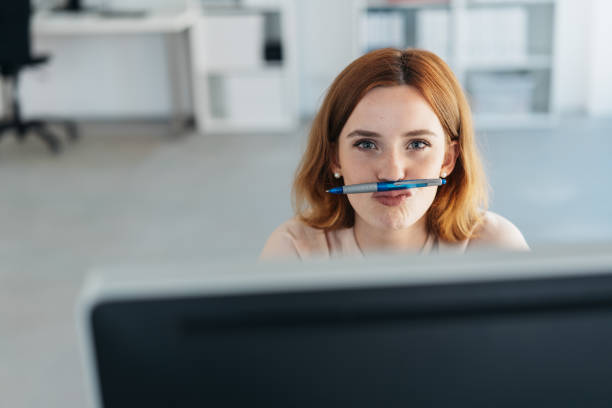 Playful businesswoman with a pen mustache stock photo