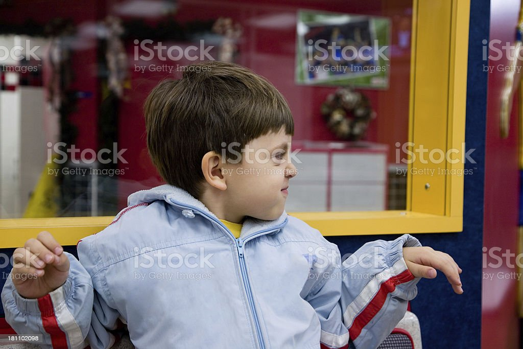 Playful Child in a Fast Food Restaurant royalty-free stock photo
