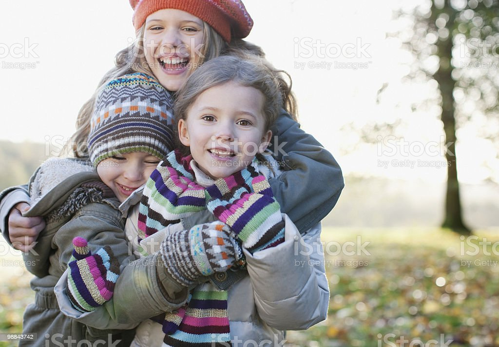 Playful children smiling outdoors in autumn stock photo