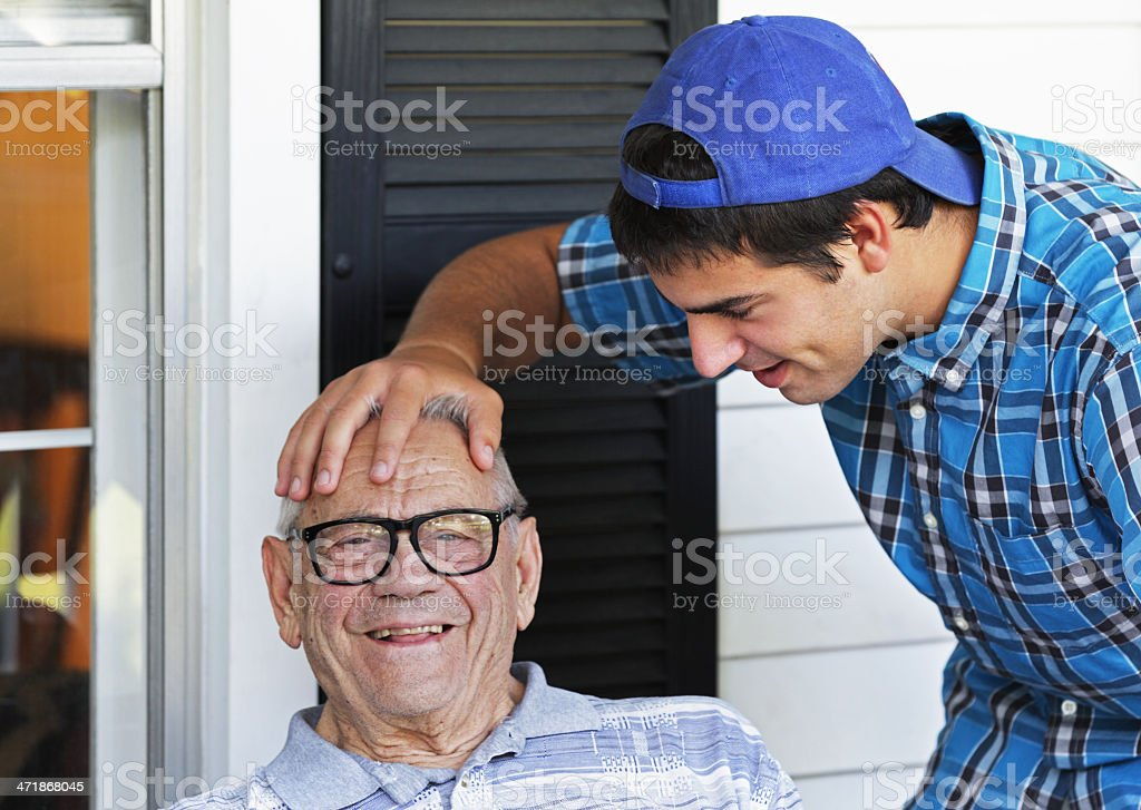 Playful College Student Grandson Teasing Grandfather stock photo