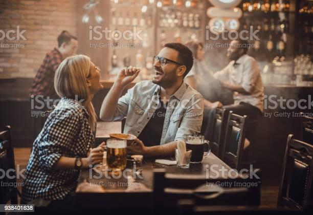 Playful couple having fun with peanut during their night out in a pub picture id938401638?b=1&k=6&m=938401638&s=612x612&h=kndto4rh46x3ul0ivsrom aeblvjpb30wxnvty2rhtw=