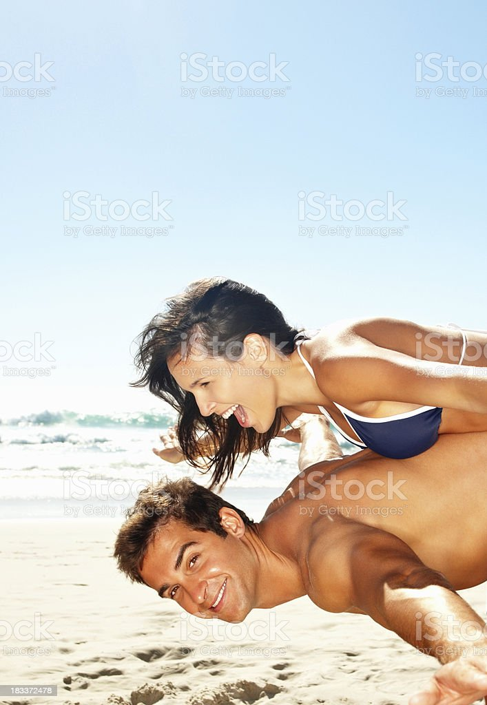 Playful couple on beach royalty-free stock photo