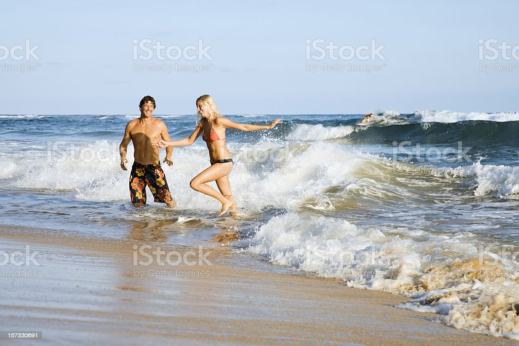 Playful Couple on The Beach stock photo