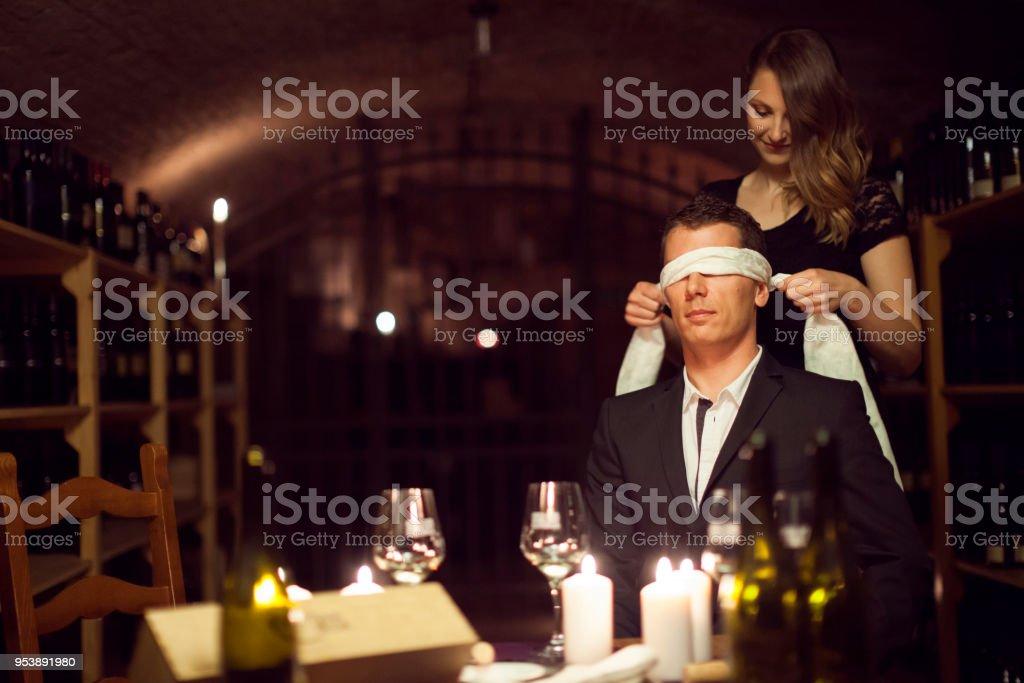 Playful Couple Tasting Wine Blindfolded stock photo