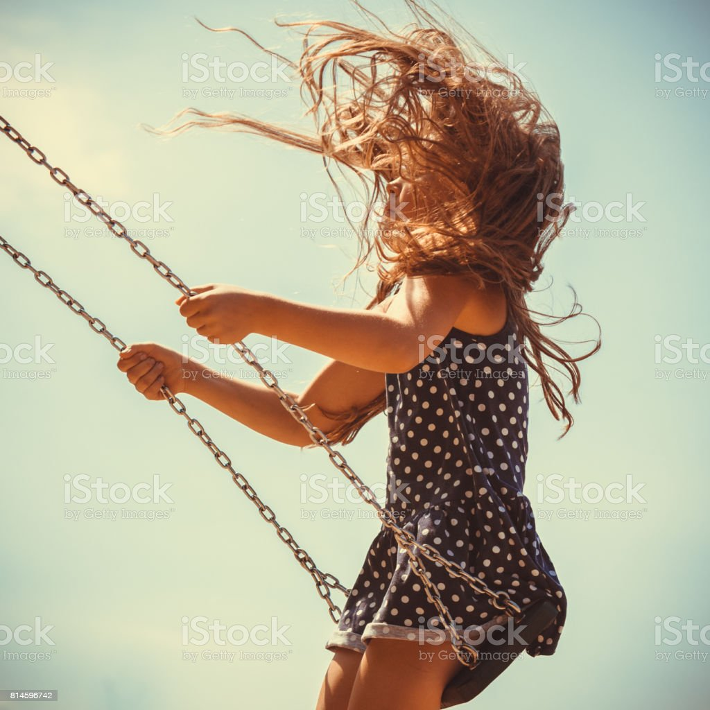 Playful crazy girl on swing. - foto stock