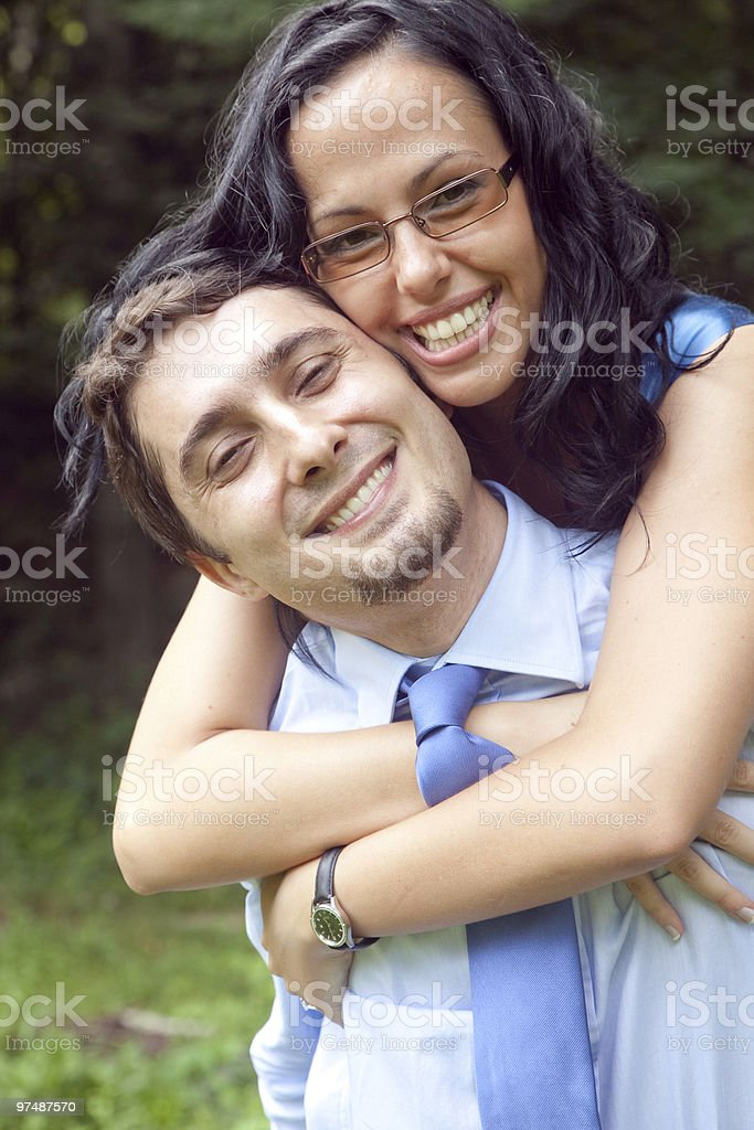 Playful cute young couple hugging outdoor royalty-free stock photo
