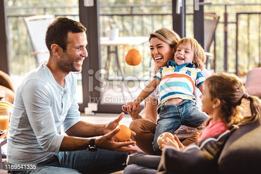 1159543952istockphoto Playful family having fun in the living room. 1159541335