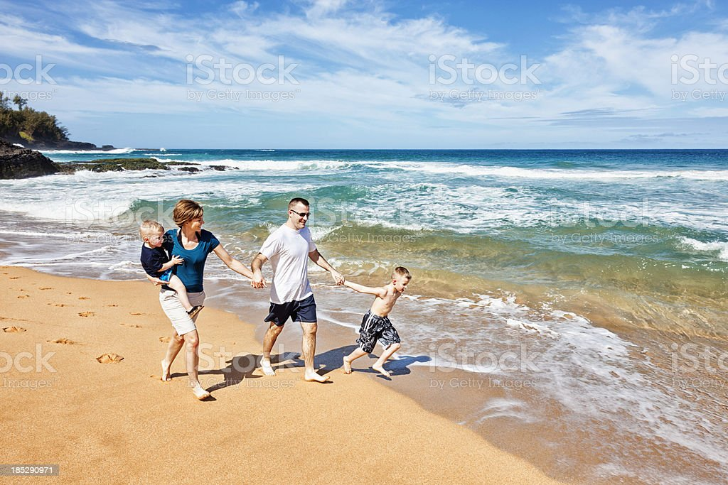 Playful Family of Four at The Beach royalty-free stock photo