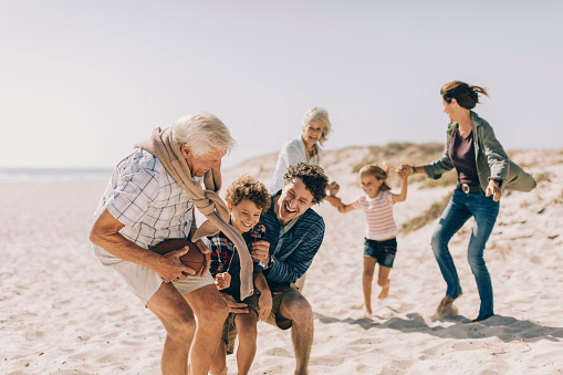Close up of family enjoying time on the beach